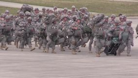 BASE CHARLSTON, MAY 2015, US Air Force Group. US Air Force A group of US soldiers march over a airfield stock video footage