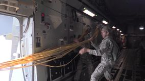 BASE CHARLSTON, MAY 2015, US Air Force Two. US Air Force. Two Soldiers take the jump ropes back in the aircraft stock video