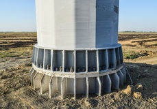 The base of the column power line support. Massive metal pole Stock Image