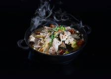 Base de soupe à style chinois de HotPot de Chinois Photographie stock libre de droits