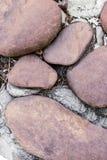 Base do close-up de pedra da pedra da terracota no Web site duro cinzento do projeto da carcaça do backgroundcement fotografia de stock royalty free