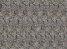 Base folded hexagonal stones tiles wall fragment square symmetrical texture Royalty Free Stock Images