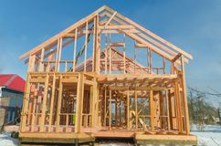 Construction of wooden frame house. Base, frame of a wooden house, racks and partitions royalty free stock photo