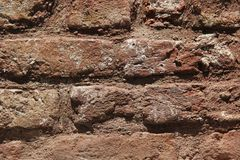 Cemented gray masonry with falling plaster. royalty free stock images