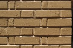 Cemented gray masonry with falling plaster. royalty free stock photo