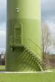 Base of windturbine with stairs and entrance door. Royalty Free Stock Images