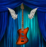 Base Guitar with wings. On stage Royalty Free Stock Photography