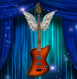 Base Guitar with wings. Before stage curtains Stock Photography