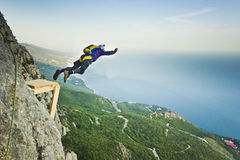 Base-jumper jumps from the cliff Royalty Free Stock Photo