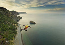 Base-jumper jumps from the cliff Royalty Free Stock Image