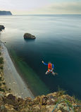 Base-jumper jumps from the cliff Stock Photography