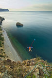 Base-jumper jumps from the cliff Stock Photo