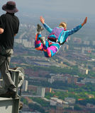 Base-jumping. The girl jumps from the big height royalty free stock photography