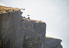 Base Jumping Norway. Freedom, flight. BASE Jumping from Kjeragbolten rock. Rogaland, Norway Royalty Free Stock Photo