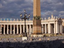 Base of Obelisk in Vatican City. Saint Peter square in Vatican City, chairs prepared for Pope`s address and base og Obelisk Royalty Free Stock Image