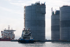 Base of oil platform and tugs Stock Photos