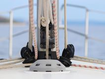 The base for securing the mainsail on the deck of a cruise yacht. Folding carriages and ropes for raising sails. Bermuda sloop equ. Ipment. The device and royalty free stock images