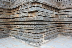 The base of the temple walls consist of moldings with friezes that consist of from bottom to top elephants, lions, scrolls, hors Royalty Free Stock Image