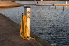 Base for water and power supply for yachts and boats Royalty Free Stock Images
