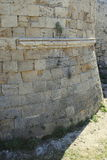Base weathered fortress wall on the island of Rhodes in Greece Royalty Free Stock Image