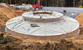 Base for a windmill built in the wind farm Stock Photo