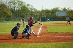 Baseball. Player hitting ball Stock Photo