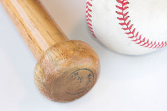 Baseball. And bat against a white background stock image