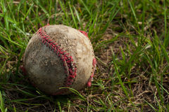 Baseball. Old Baseball in the grass Royalty Free Stock Image
