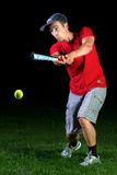 Baseball. An athlete playing baseball in the night Royalty Free Stock Photography