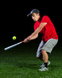 Baseball. An athlete playing baseball in the night Stock Image