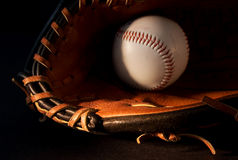 Baseball (2). Baseball glove and ball on black Stock Images