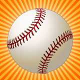 Baseball. Over a sunburst coming straight toward the viewer Royalty Free Stock Image