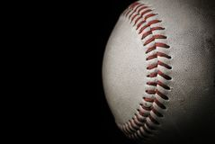 Baseball. Close up of a baseball over a black background Stock Images