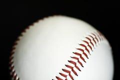 Baseball. Macro shot of a white Baseball with red stiching stock photography
