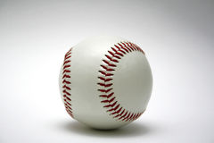 Baseball. A baseball on white surface Stock Image