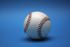 Baseball. A baseball on blue surface Stock Photography