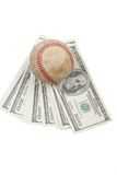 Baseball. Is the ball at the one hundred dollar Banknotes Royalty Free Stock Image