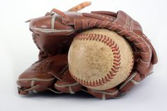 Baseball. With red stitching and outfielders glove (mitt) on a white background,sports Royalty Free Stock Photo