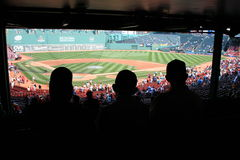 Baseball. Father and sons watching a game at Fenway Park, Boston stock photo