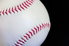 Baseball. A baseball on a black background Royalty Free Stock Photos