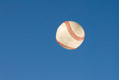 Baseball. A baseball flys through the air after being hit for the fence Stock Photography