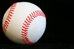 Baseball. Closeup of a baseball with a black background Stock Photography