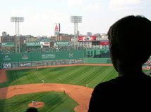 Baseball. Young boy watching a game at Boston's Fenway Park stock photo