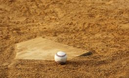 Baseball. One baseball on home plate at a sports field Stock Photos