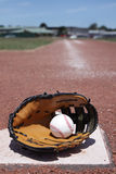 Baseball. A baseball glove and ball Stock Photos