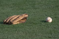 Baseball. View of the Baseball and glove on the field Royalty Free Stock Photos