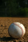 The baseball. Old baseball on field royalty free stock photos