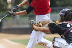 Baseball Action Image -- Batter with ball in image Stock Image