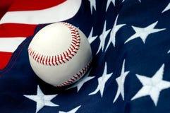 A baseball on the American flag
