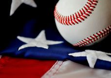 Baseball - American Pastime. Baseball and American flag in a concept image portrayal of America's National Pastime Royalty Free Stock Photo